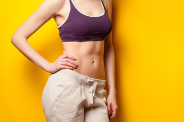 Woman showing her abs after weight loss