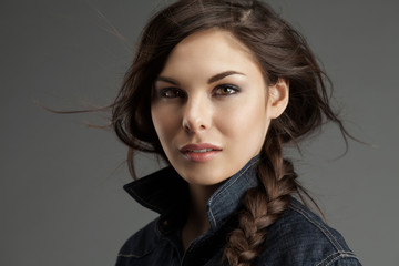 Attractive woman in a denim shirt with flying locks