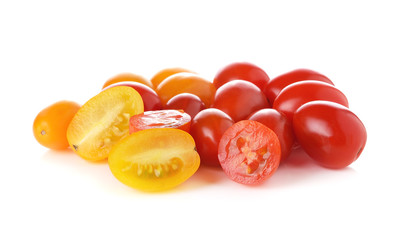 red and yellow tomatoes on white background