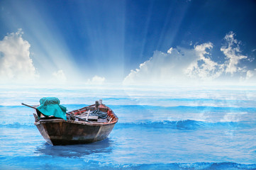 fishing boat on the sea with sunray