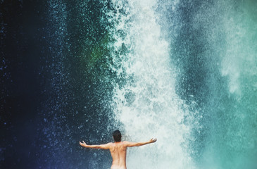 man in waterfall