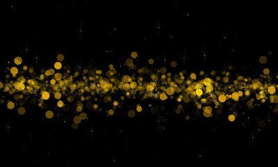 Gold and yellow glitter sparkle on black background