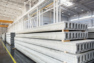 Stack of reinforced concrete slabs in a factory workshop