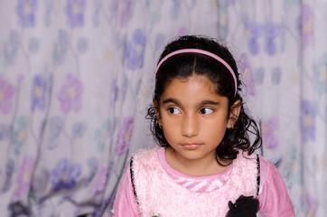Little girl child looking sideway