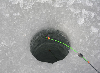 Fishing rod near the hole