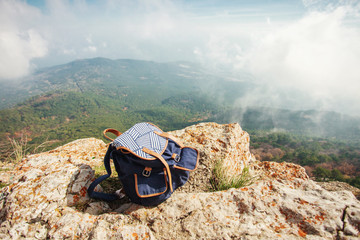 backpack on top of the mountain