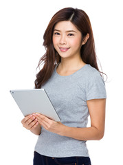 Student happy with holding a computer tablet