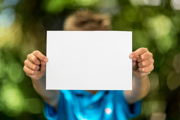 Boy with blank piece of paper