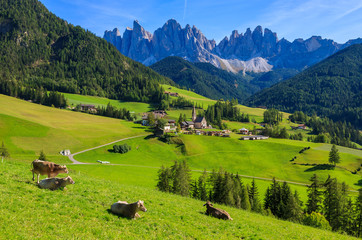 View of mountain valley and Santa Maddalena village, Dolomites