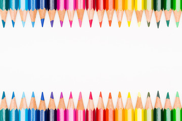 Colored pencils lined up in frame