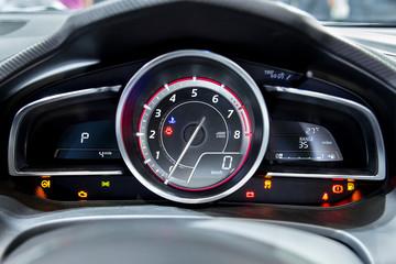 Close up shot of modern speedometer in a car.