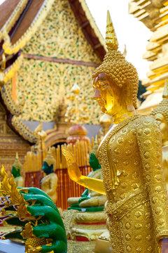 Yellow sapphire standing buddha statue in Chiangmai, Thailand