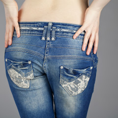 Back view, body part female blue jeans