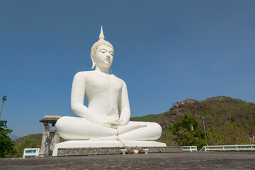 Big white buddha statue on the mountain , Thailand.
