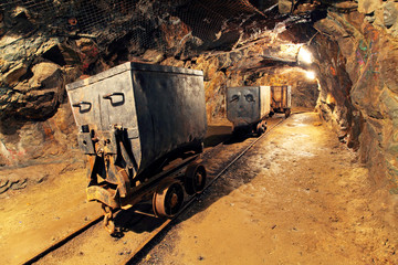 Wall Mural - Mining cart in silver, gold, copper mine
