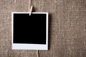 Polaroid. Blank photo card on canvas background
