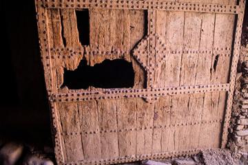old broken massive wooden doors Kasbah, Morocco