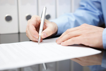 closeup of bussinessman is signing contract with documentation i