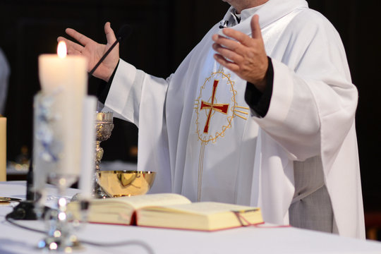 priest and worship at the altar