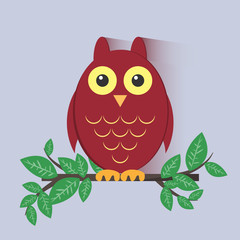 Red Owl Sitting on a Branch