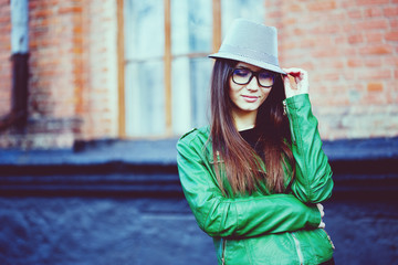 Portrait of a beautiful adult sensual woman in glasses