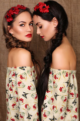 beautiful girls  in dresses with prints of red poppies