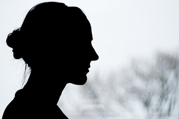 Lady Silhouette with blurry tree background