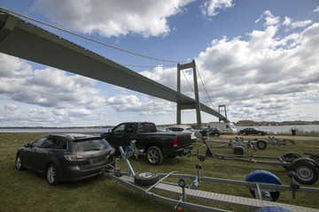 Cars towing boat trailers