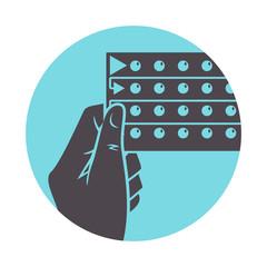 Hand holding birth control pills