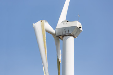 Wind turbine with broken wings after a storm