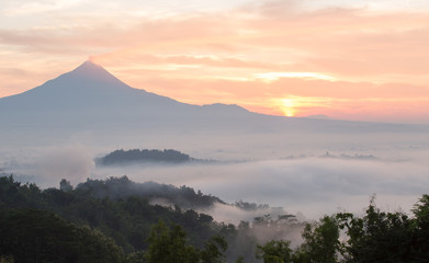 Colorful sunrise with Merapi volcanoand Borobudur temple