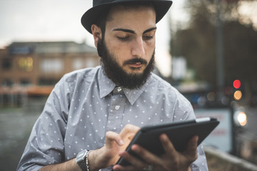 young handsome hipster gay modern man using tablet