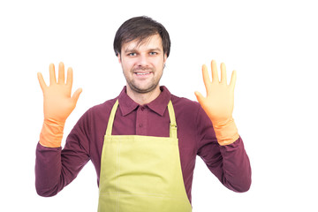 Portrait of  young man with apron and gloves ready to clean
