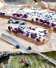 tart with blueberries and cream