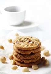 the chocolate and macadamia cookies on dish set for coffee break