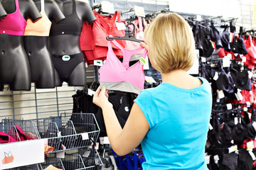 Woman chooses bra for doing sports