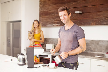 Man making coffee for his girlfriend