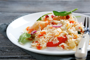 Delicious rice with onions and basil