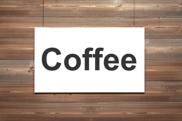 canvas hanging on wooden wall coffee