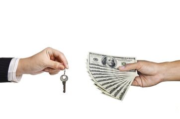 hand holding key and holding money for a deal of buying house