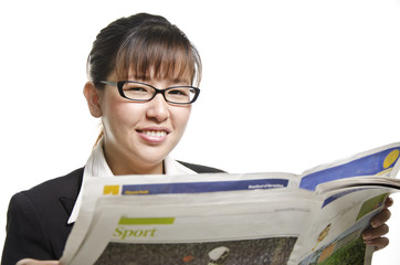a business woman reading newspaper