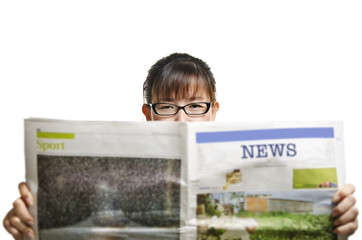 a woman reading newspaper against white background