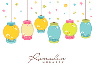 Ramadan Kareem celebration with colorful hanging lanterns.