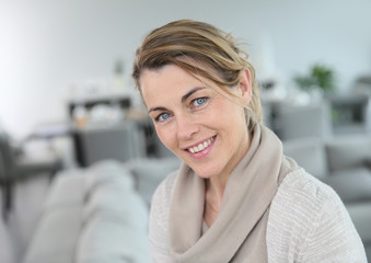 Portrait of middle-aged blond woman at home