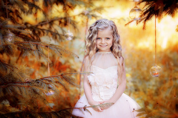 Little cute girl walking in the woods