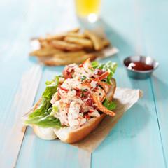 lobster roll on rustic wood planks