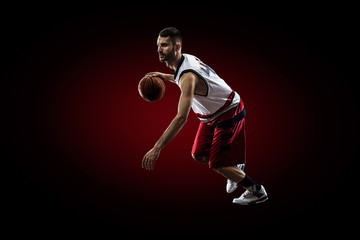Basketball player in action is flying high