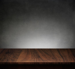 Wood table with dark concrete texture background