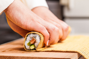 cook turns roll closeup