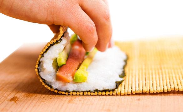 chef turns nori sheet
